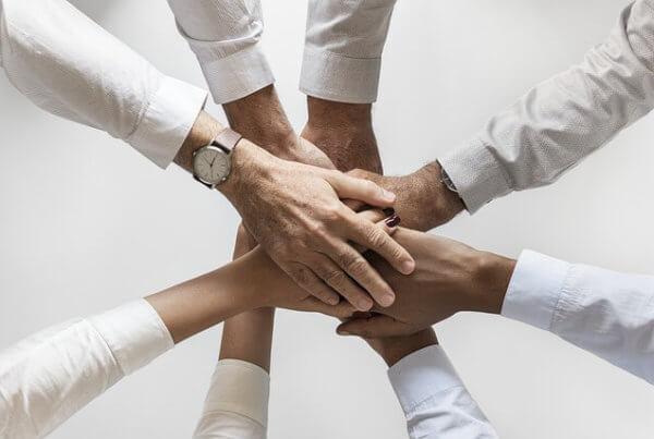 Team Zusammenhalt im Unternehmensberater Job